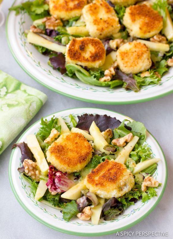 Warm crisp Fried Goat Cheese Salad with apples, walnuts and greens. This easy salad recipe is easy to make, but looks and tastes elegant. Perfect for fall,