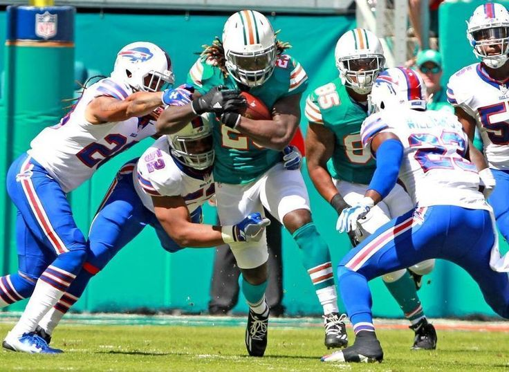 Bills vs. Dolphins:    October 23, 2016  -  28-25, Dolphins  -      Miami Dolphins Jay Ajayi runs through the Buffalo Bills defense in the first quarter at Hard Rock Stadium in Miami Gardens, Florida, October 23, 2016.  CHARLES TRAINOR JR ctrainor@miamiherald.com