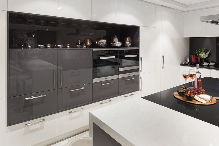 This integrated cabinetry combines the latest in Miele appliances including a combi oven and warming drawer with custom cabinetry designed and built by Urbane Projects, Perth.