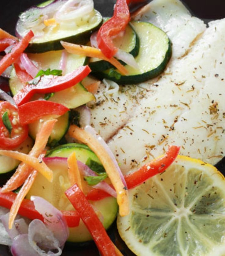 Making baked tilapia and veggies in parchment paper will be your next go-to technique. It steams the fish to perfection and there is no pan to clean up! - Everyday Dishes & DIY