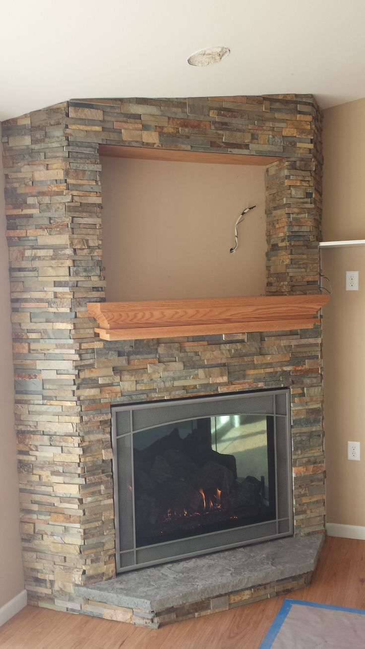 New home construction. We designed and installed the fireplace, mantle and stone work. Ochre quick stack stone panels, custom made mantle, custom order fire screen, Stellar Hearth Viewpoint 36 fireplace with porcelain reflective panels. Stellar holds a patent on the only corner designed fireplace on the market. This design gives you the best view point from anywhere in the room. You can also choose traditional log or contemporary glass media to customize your space.