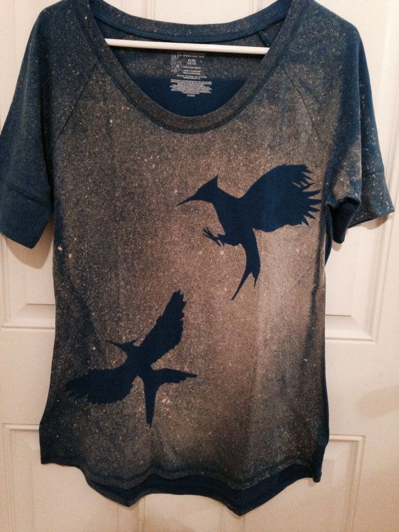 The Hunger Games Mockingjay silhouette tank top in by ShirtsOnFire ...
