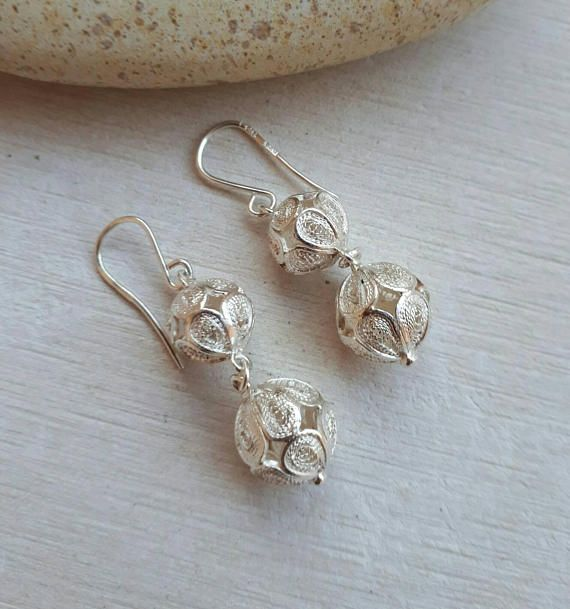 Check out this item in my Etsy shop https://www.etsy.com/uk/listing/206666949/handmade-sterling-silver-filigree