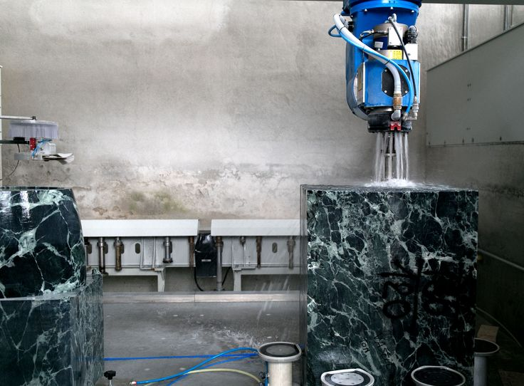 CNC machine working on Verde Alpi #marble block to get a #basin.