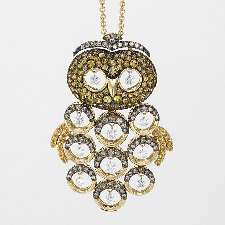 owl pendant in Yellow gold with diamonds, brown diamonds and sapphires