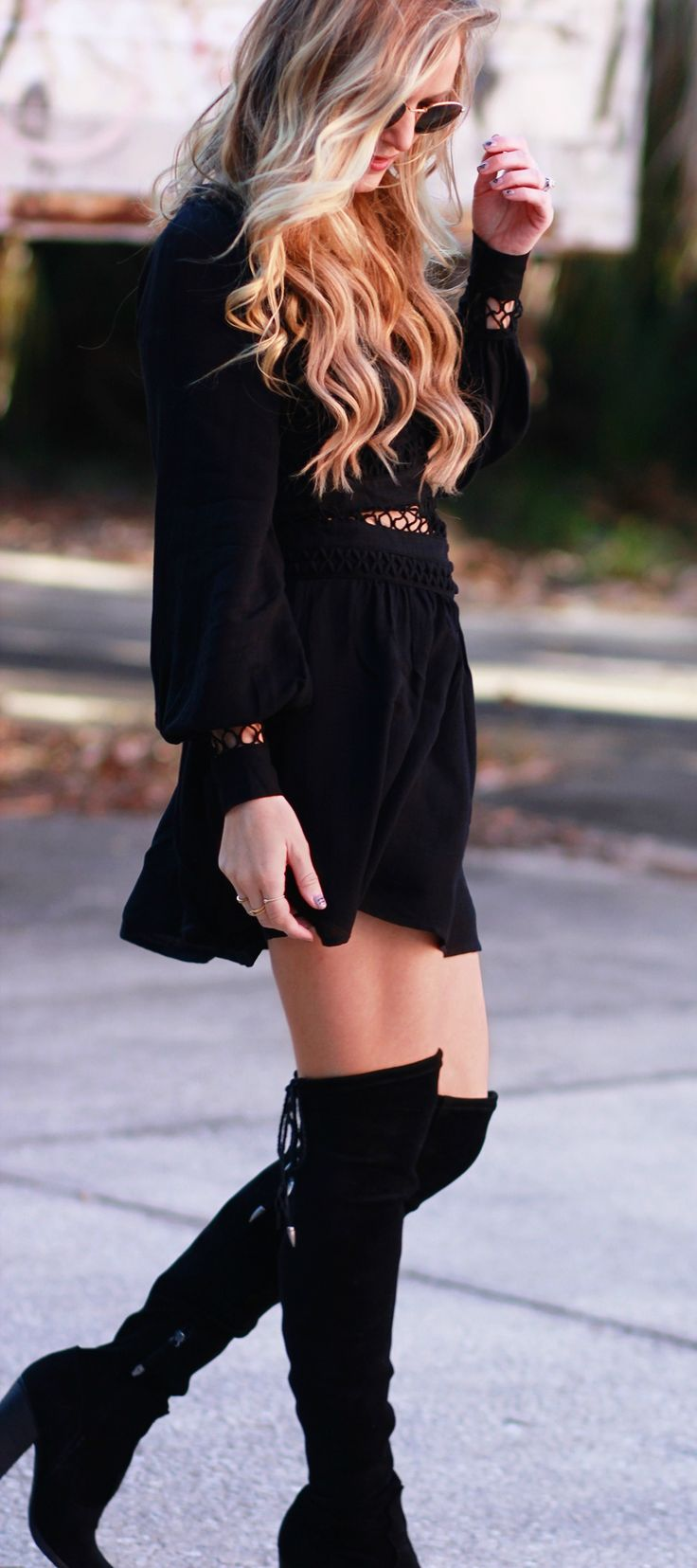All black fall outfit styled with Free People mesh dress, Dolce Vita over the knee boots, and round Ray Ban sunglasses