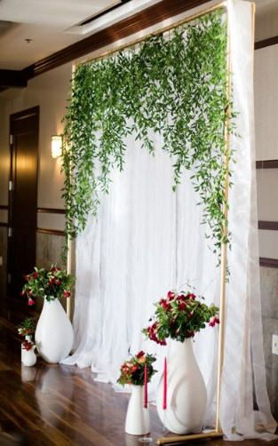 Italian ruscus backdrop for a wedding.