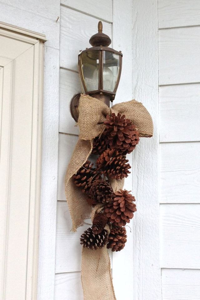 ! Love! Burlap ribbon and pinecones wired together!