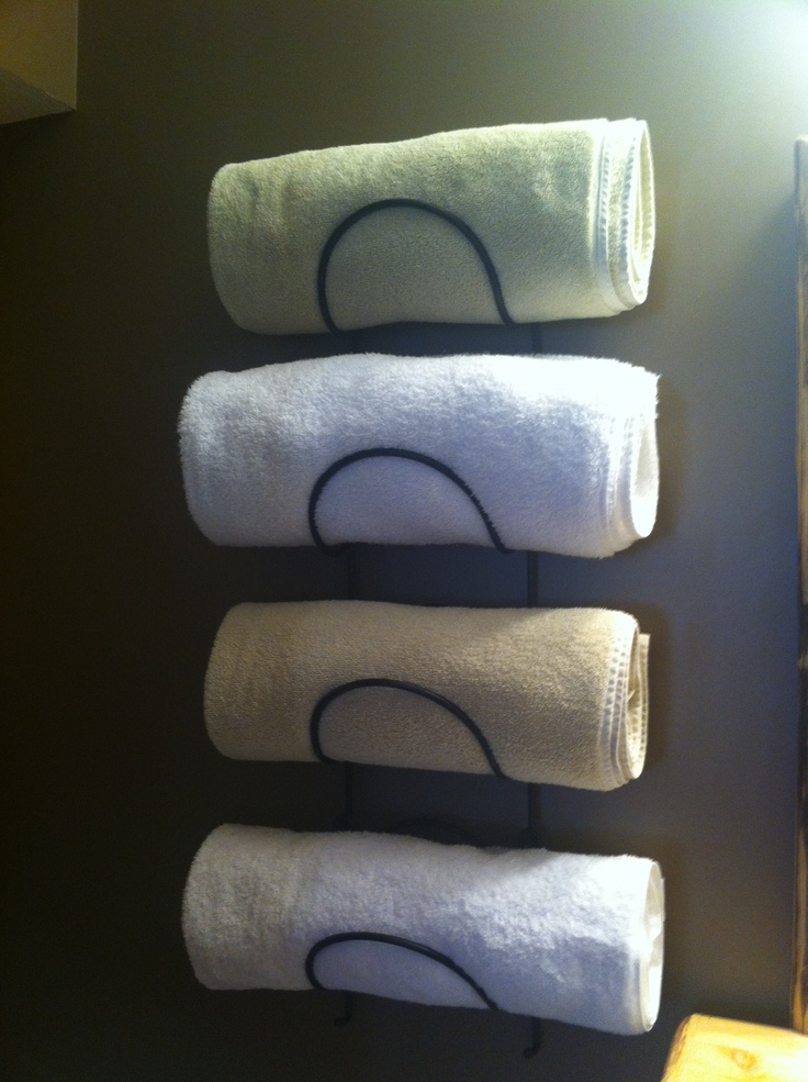 Our wine rack towel storage home organization for Small bathroom towel storage