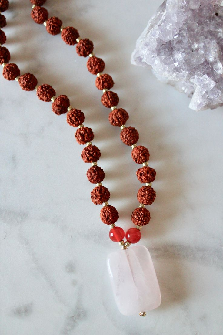 Pregnancy Mala - Rose Quartz enhances fertility and nourishes existing relationships. Rainbow Moonstone supports all stages of pregnancy, from conception to post-partum, and helps a woman make the powerful transition into motherhood with ease. Carnelian supports and balances the entire reproductive system.