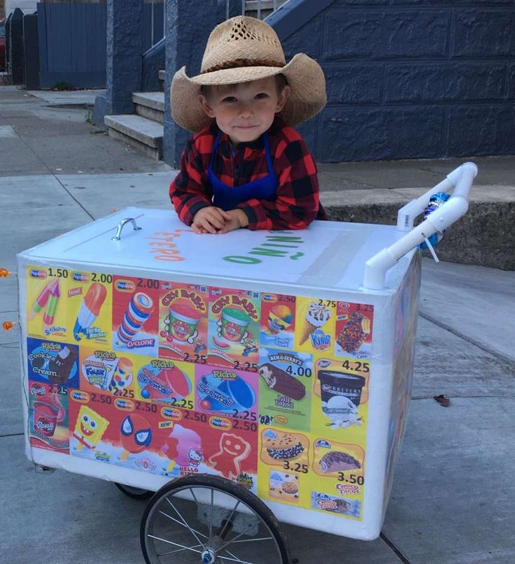 """MISSION ICE CREAM MAN: Some excellent execution here. Judy and Murray Haworth write: """"Our 2-year-old wanted to be a Mission Ice Cream Man, so we made him a pushcart. El Niño Paletero gave out 100 free otter pops around the Mission tonight. He had a blast and even ran into his twin!"""" Photo: Super Crafty Costume Contest"""