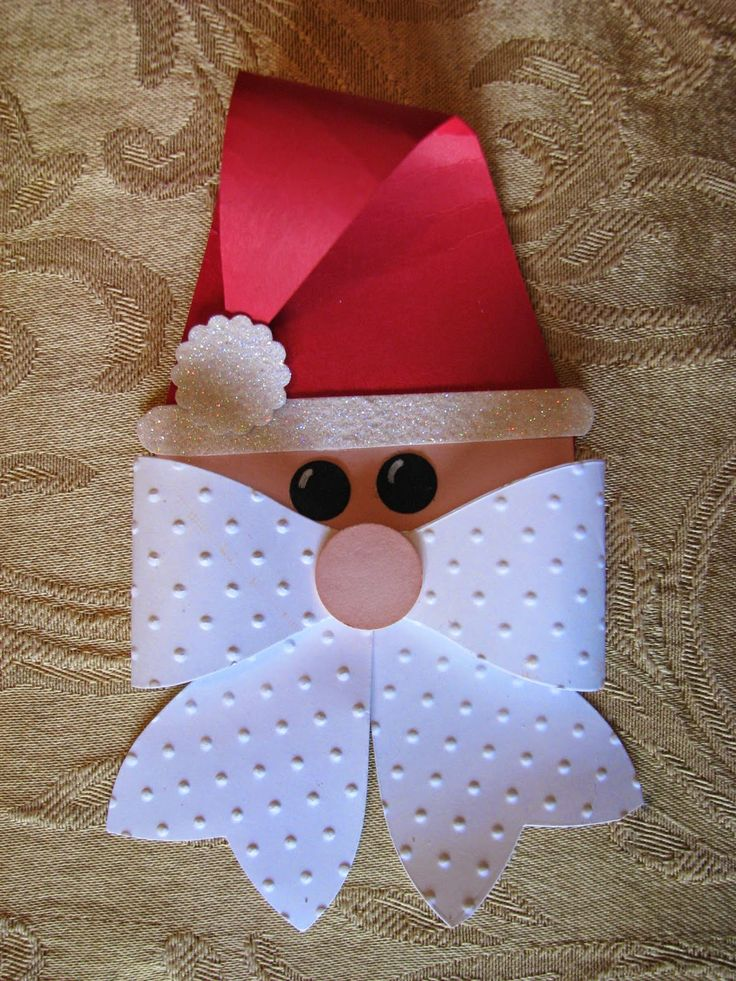 Get ready for your holiday gift wrapping by making up a bunch of these adorable Santa package toppers.  They can also be used for gift tags ...