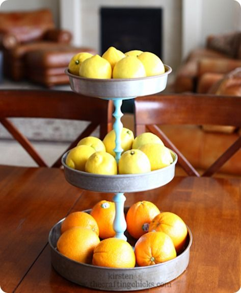 What a cute idea!  We have cake pans and candlesticks just like this at Jeffrey's Antique Gallery! You can be making your own tiered stand in no time!