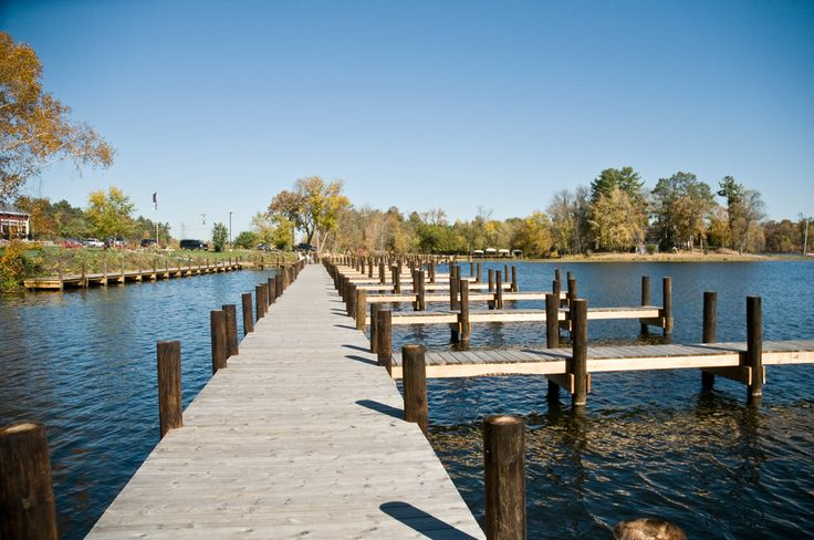 Boat dock made from eco-friendly building material called Arborwood, a thermally modified wood distributed by Intectural.
