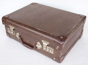 My trusty old cardboard school suitcase was green with white flecks.  I got it for christmas the year I went to the senior primers.  I was sooo excited.  It's the same year I got my red leather sandals.