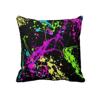 Colorful Neon Paint Splatters on Black Pillow by cutencomfy