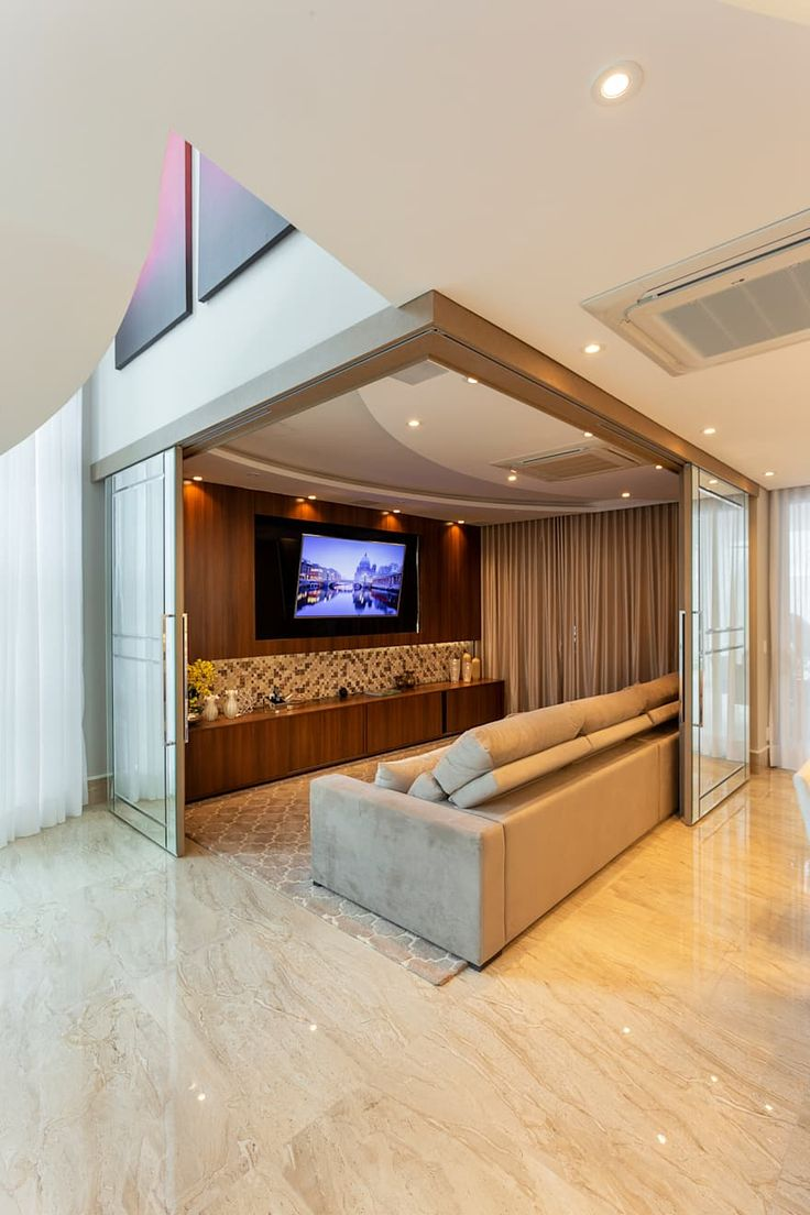 TV room integrated into the living room by sliding door with beveled mirrors! Home Design Decor, Home Theater Room Design, Home Cinema Room, Home Theater Rooms, Home Room Design, Dream Home Design, Home Interior Design, Home Decor, Home Theaters Pequenos