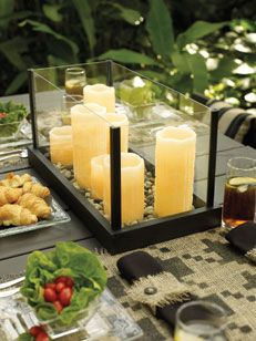 Bathe the night in an enchanting glow with simple candle trays that can nestle on your table as a centrepiece or suspend in mid air for a magical atmosphere
