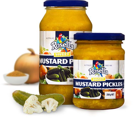 Sweet Mustard Pickles  A delicious heirloom recipe from Rosella that has been gracing our tables for generations. Flavoursome sweet mustard pickle, tastes sensational on any cold meat sandwich, crispy bread roll or wrap. A perfect accompaniment to a traditional ploughman's lunch.  Available in 250g and 550g jars.