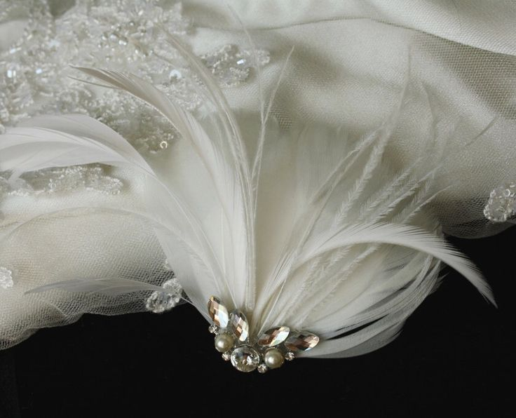 Bridal Fascinator, Wedding Fascinator, Ivory Feather Fascinator, Wedding Hair Accessory - ANGEL by PowderBlueBijoux on Etsy https://www.etsy.com/listing/90091848/bridal-fascinator-wedding-fascinator