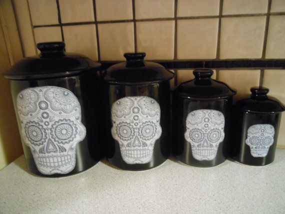 This listing is for a set of 4 black ceramic kitchen canisters. The canisters are 7 tall x 7 wide, 6 tall x 6 wide, 5 tall x 5 wide and 4 tall x 4