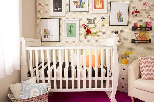 Decorating a baby's nursery doen't have to be expensive. A simple pegboard attached to one wall and decorated it with coloured artworks that can be easily attached and regularly updated.