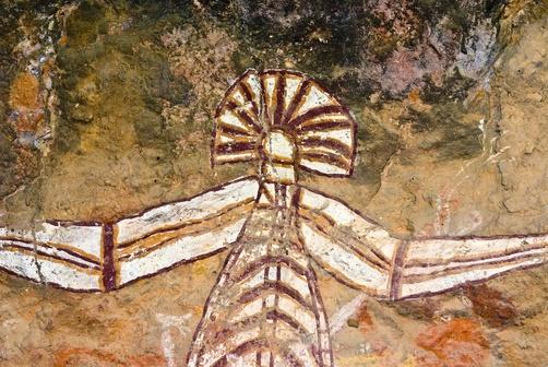Ancient Aboriginal rock art depicts Nabulwinjbulwinj on a cliff wall.  Location:Nourlangie, Nawurlandja, Anbangbang Billabong, Kakadu National Park, Northern Territory, Australia