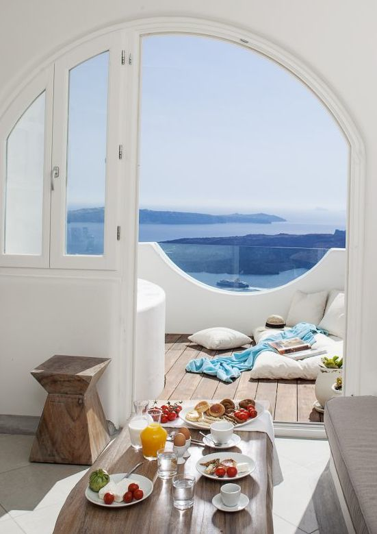 Crisp White Home Boasts Traditional Santorini Architecture With Modern Touches