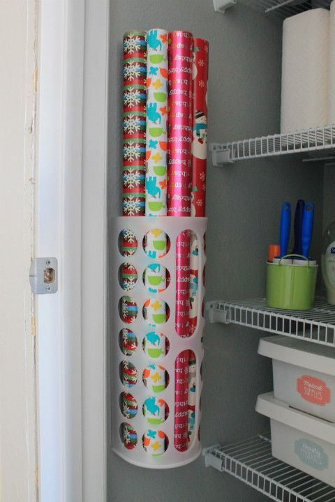What a great way to get organized by utilizing wall space + keeping the floor clear.  The wrapping paper holder is actually a $1.50 trash bag holder from IKEA!