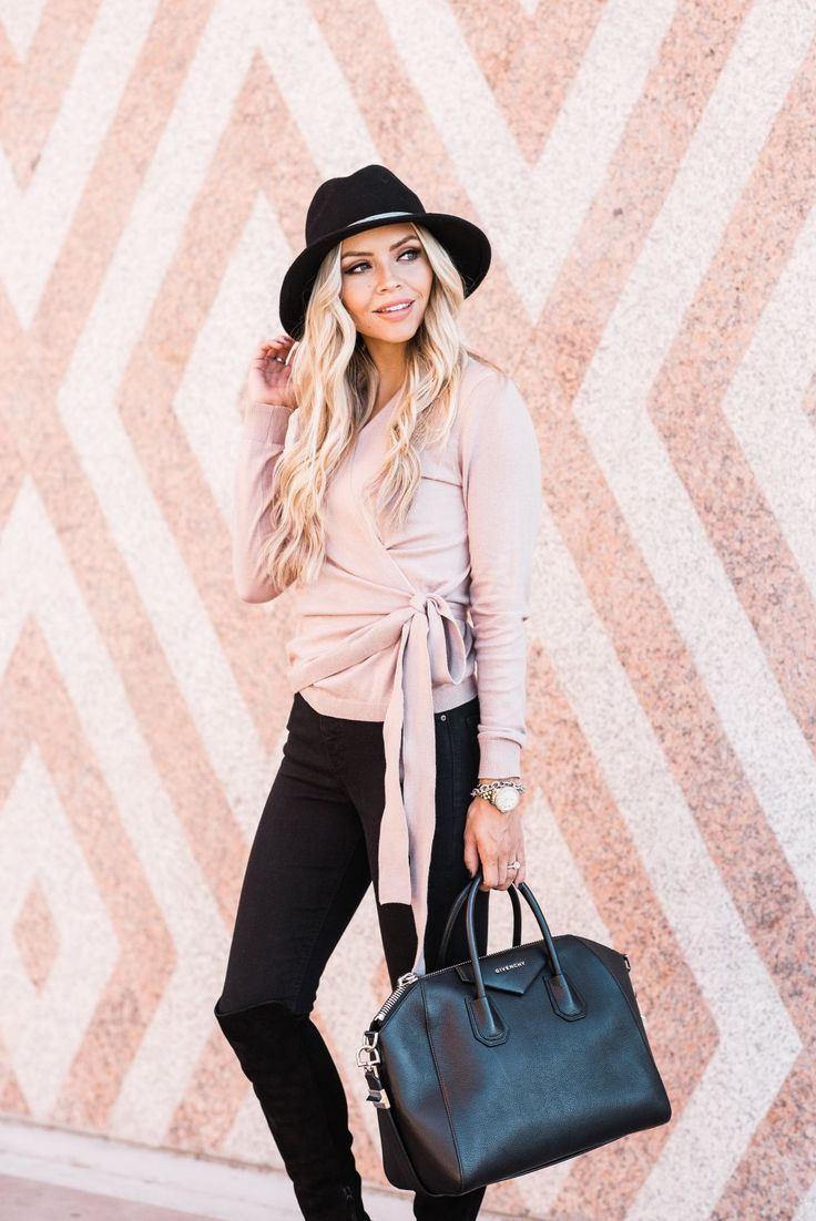This pink wrap sweater is to die for! It is perfect for spanning multiple seasons and it is SO soft! This pink color and the bow details make it very feminine! This also comes in a Heather Grey color! #trulydestiny #womensfashion #datenight #sweaterweather #valentinesday