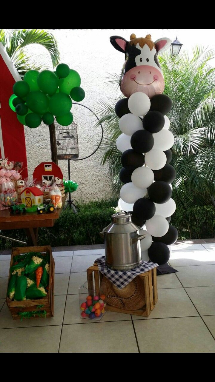 Fiesta tematica, vaca, decoracion con globos
