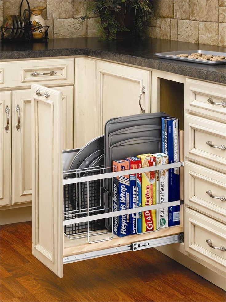 Pull out tray divider for cookie sheets, pizza pans, and aluminum foil....want this.