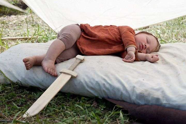This is just eye candy. I like the solution of rope wrapped wood sword handle to protect little hands.