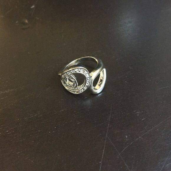Lia Sophia Ring D like swirly pattern with stones. Never worn. Great condition. Size 7 Lia Sophia Jewelry Rings