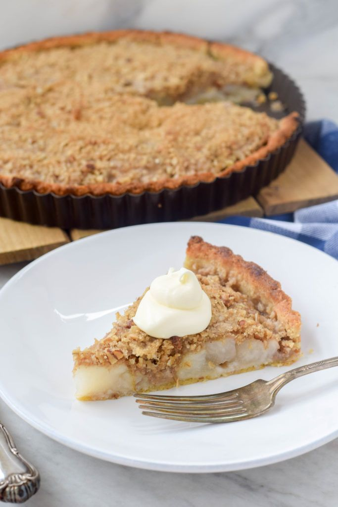 An elegant pear tart with pecan streusel. Perfect for Thanksgiving or other winter holidays.