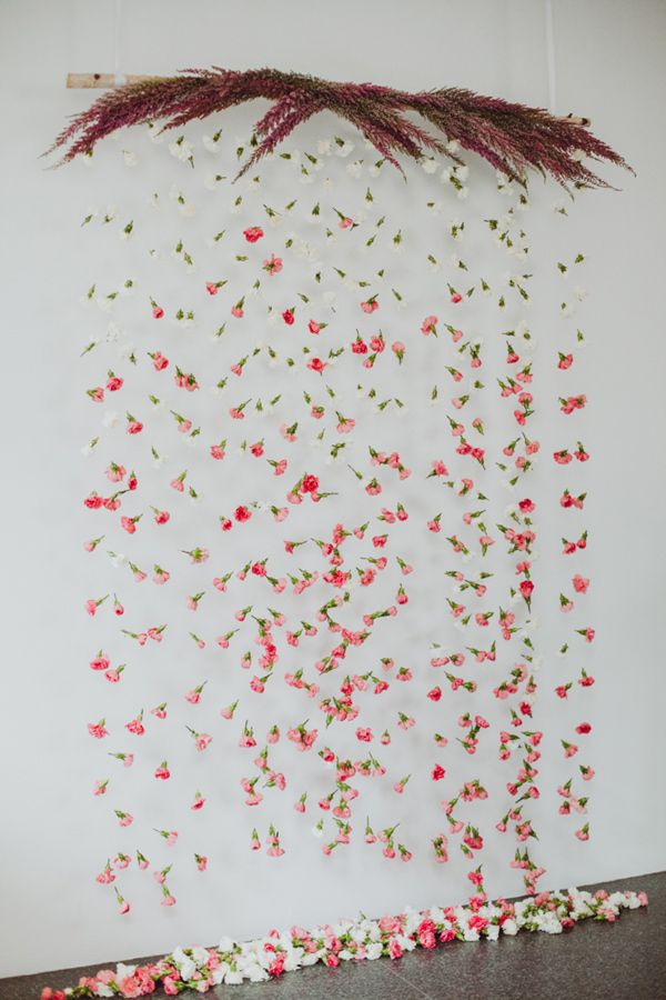 floral backdrop - photo by Amber Gress Photography http://ruffledblog.com/stylish-manhattan-wedding