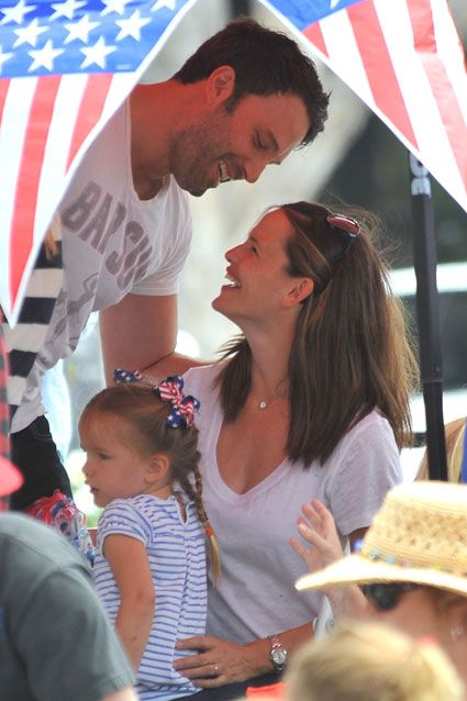Look of Love    Ben Affleck and wife Jennifer Garner exchange a loving glance as they visit an Independence Day parade with their two daughters on July 5. One of my favorite celebrity couples/families!