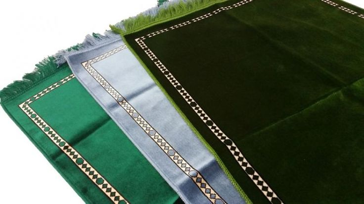 Plain prayer mats in greens and sky blue.