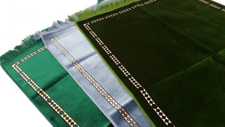 Plain prayer mats in greens and sky blue.