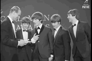 Look at George :) he takes it non-chalontly and looks proud at the camera, then John and Ringo attack him :) :)