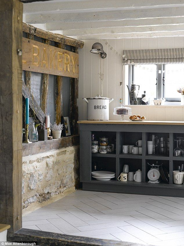 A vintage freestanding shelving unit repainted in Farrow & Ball's Down Pipe forms the main storage area of the kitchen. The oak worktops were custom-made. Oblong ceramic floor tiles from B&Q (diy.com) were laid in a herringbone pattern