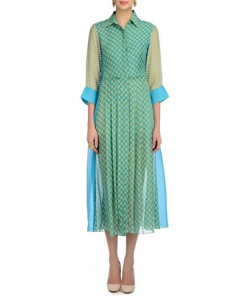 Aqua green shirt dress with floral prints and pleats. Shirt collar with button placket. Chevron print three quarter sleeves with aqua blue cuffs.Wash Care: Dry clean only