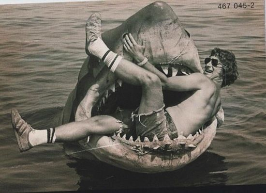 Steven Spielberg plays with the robot shark on the set of Jaws .