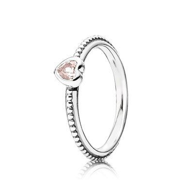 Show off your girlie side with this delicate lotus-pink heart ring. Made from sterling silver, the ring features a small heart with a sparkling synthetic pink sapphire. The tiny dot detail surrounding the ring adds a nice touch. Stack multiple rings and create your own sweet look. #PANDORA #PANDORAring