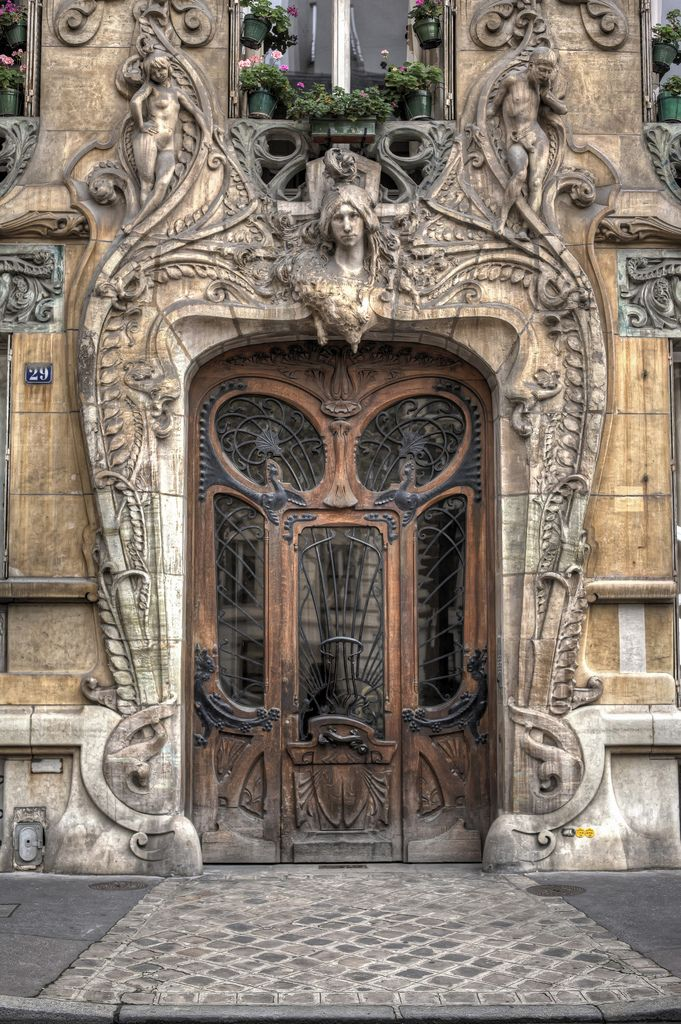 Mystical entrance at 29 Avenue Rapp in Paris' 7th, a stunning example of Art Nouveau architecture.