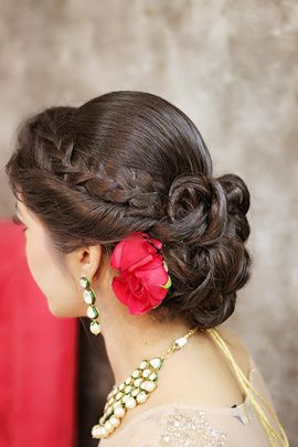 Engagement Hairstyles - Twisted Hair and Braided Hair Fringe with Messy Twisted Hair Bun and Rose in Hair | WedMeGood #wedmegood #hair #engagement #bun