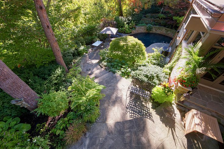 Sweeping stairs lead to a lower sitting area and a stunning sunken pool.