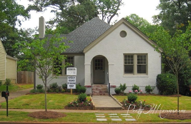 "Pretty Old Houses - house paint colors:       Sherwin Williams ""Neutral Ground"" SW7568 for the brick exterior,      ""Stone Lion"" SW7507 for the trim      ""Urban Bronze"" for the porch floor, steps and the concrete slabs by the steps."