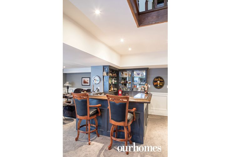 """The bar area was a labour of love crafted by the homeowners, including a kegerator, new countertops and lighting.     See more of this home in """"Transforming a Mississauga Tudor over Time"""" from OUR HOMES Oakville Spring 2017:  http://www.ourhomes.ca/articles/build/article/transforming-a-mississauga-tudor-over-time"""