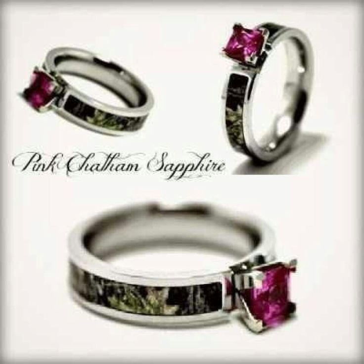 Camo wedding ring, if it had a blue diamond it would be perfect!